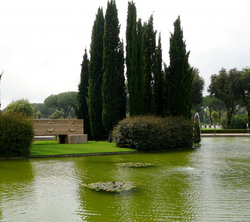 The pool surround a island of cypress and a cenotaph