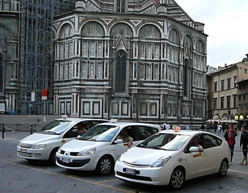 Florentine taxis sitting in wait behind the Duomo
