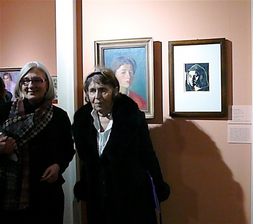 Curator Giovanna Giusti with Tinca Stegovec by two of the artist's works