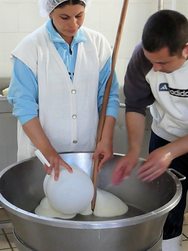 "After ""stringing"" pieces of mozzarella are carved off to form balls"