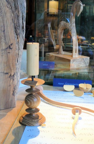 Turned and carved wooden objects in the window.