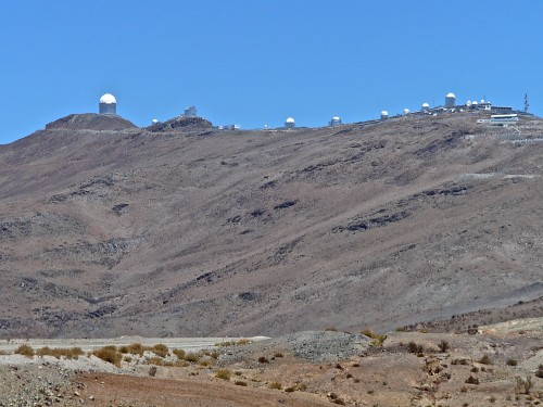 The La Silla Observatory seen from the road beyond the entry gate