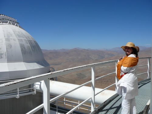 Silvia endures the wind to enjoy the view of the Atacama Desert north of La Silla