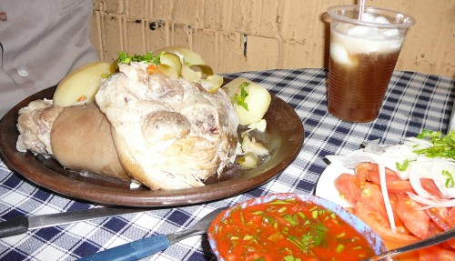 Boiled pork leg, boiled potatoes, and Chilean salad - perfect pairing for a Terremoto