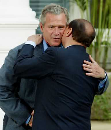 Bush and Berlusconi - too close for comfort