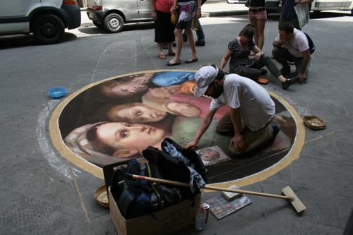 Kelly and another street artist put the finishing touches on Raphael's Madonna of the Chair